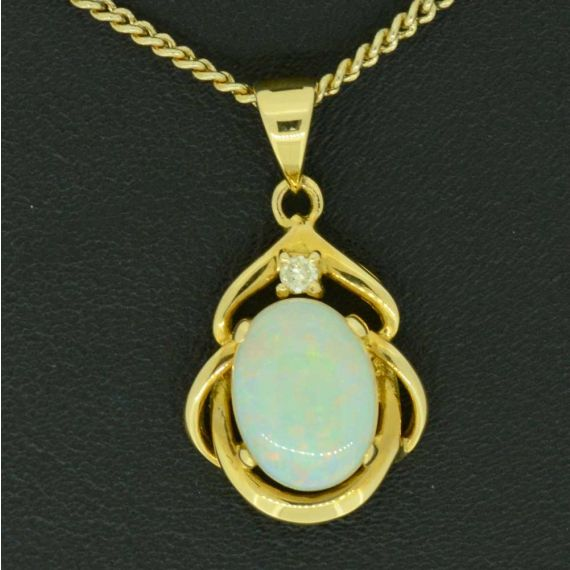 18ct Yellow Gold Solid Opal Pendant with one diamond
