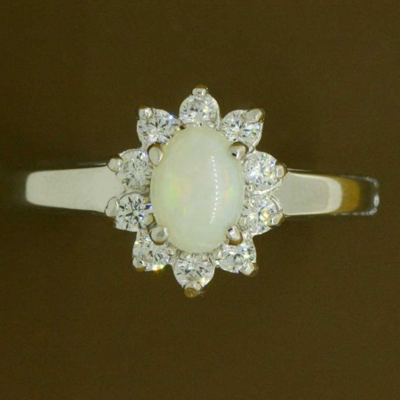 Sterling silver solid opal ring surrounded by crystals
