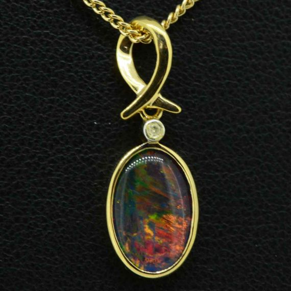 9ct triplet opal pendant set with a diamond 12mmx8mm