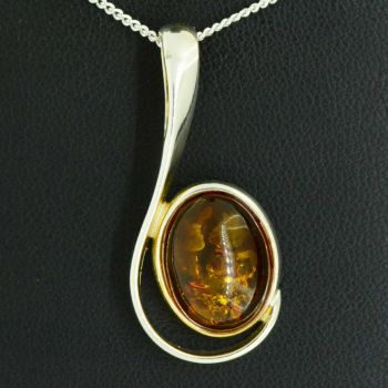 sterling silver amber pendant in a swirl design
