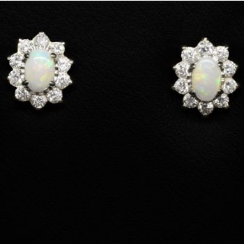 Sterling silver solid opal earrings surrounded by crystals