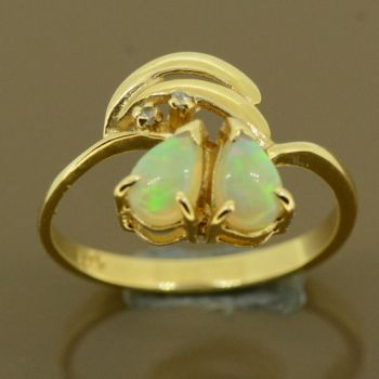 14ct solid opal ladies ring with diamonds