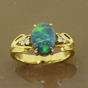 black opal ring set in 18ct yellow gold (10mmx7mm)
