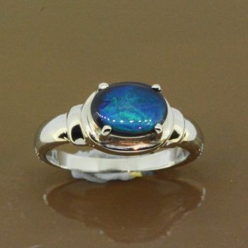 Black opal ring set in 18ct white gold (9mmx7mm)