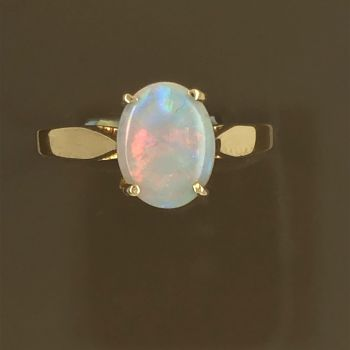 Solid Opal Ring set in 14ct gold (9mmx7mm)