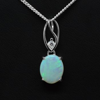 Solid opal pendant set in sterling silver 11mmx9mm