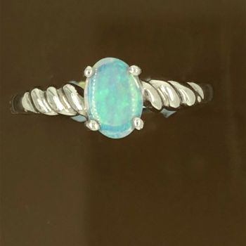 Solid Opal Ring set in 18ct white gold (7mmx5mm)