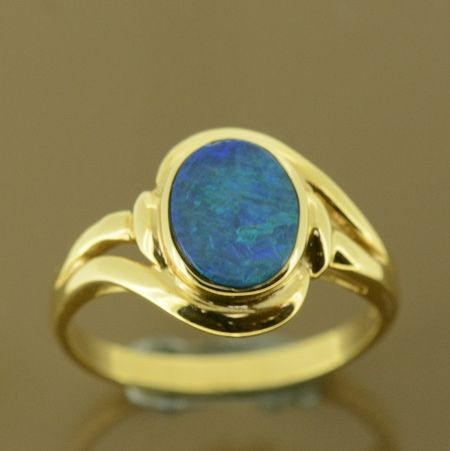 Doublet opal set in 14ct yellow gold ring
