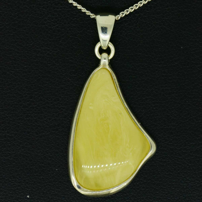 Sterling silver cream coloured amber pendant
