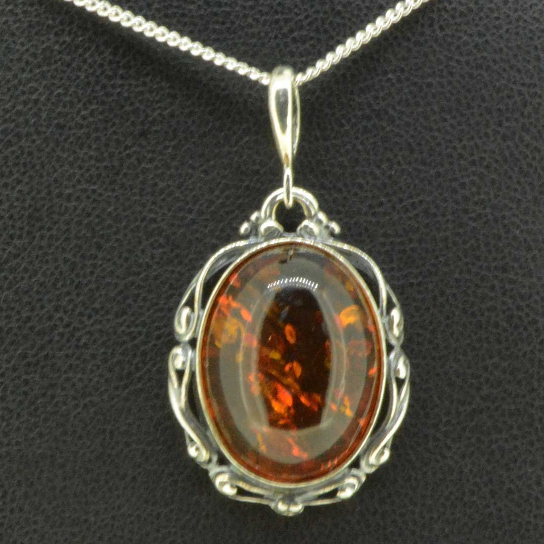 Antique style sterling silver amber pendant