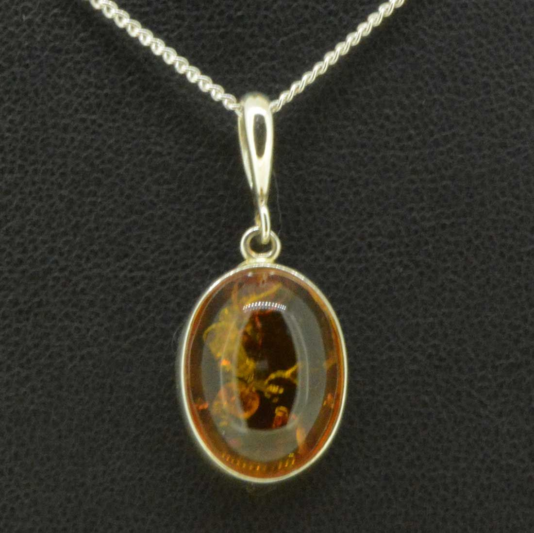 Simple sterling silver amber pendant