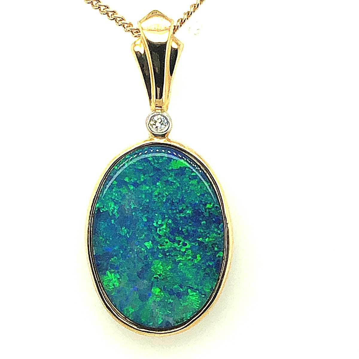 Doublet opal pendant set in 14ct  gold 19mmx14mm