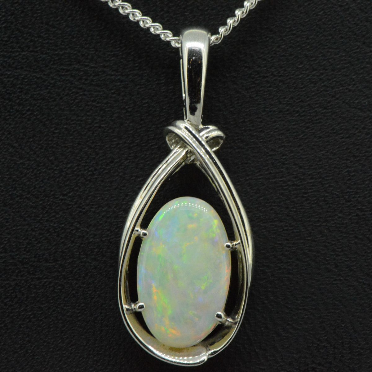 14ct white gold solid opal pendant (14mm x 9mm)