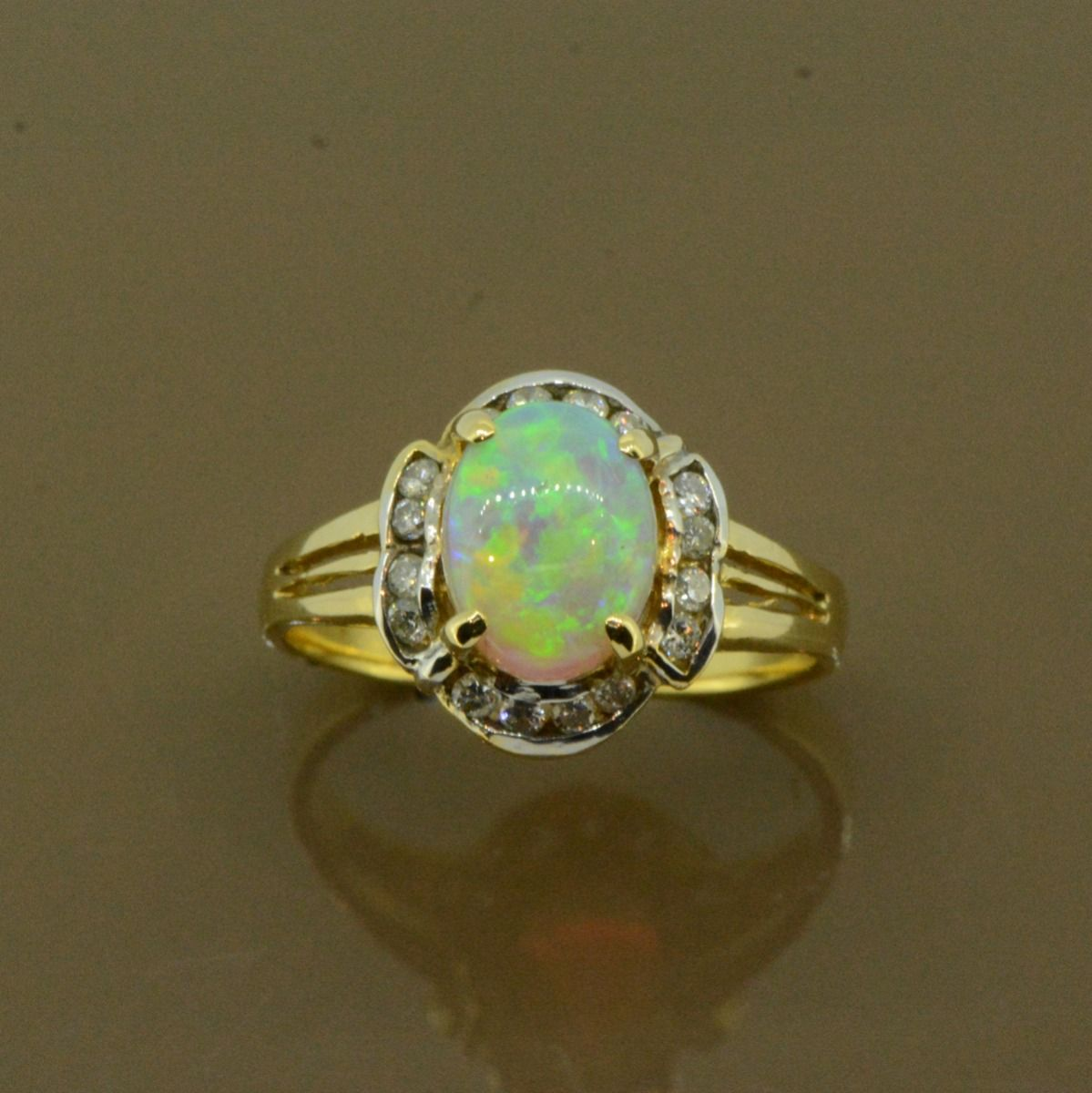 18ct Yellow Gold Solid Crystal Opal Ring set with Brilliant cut Diamonds