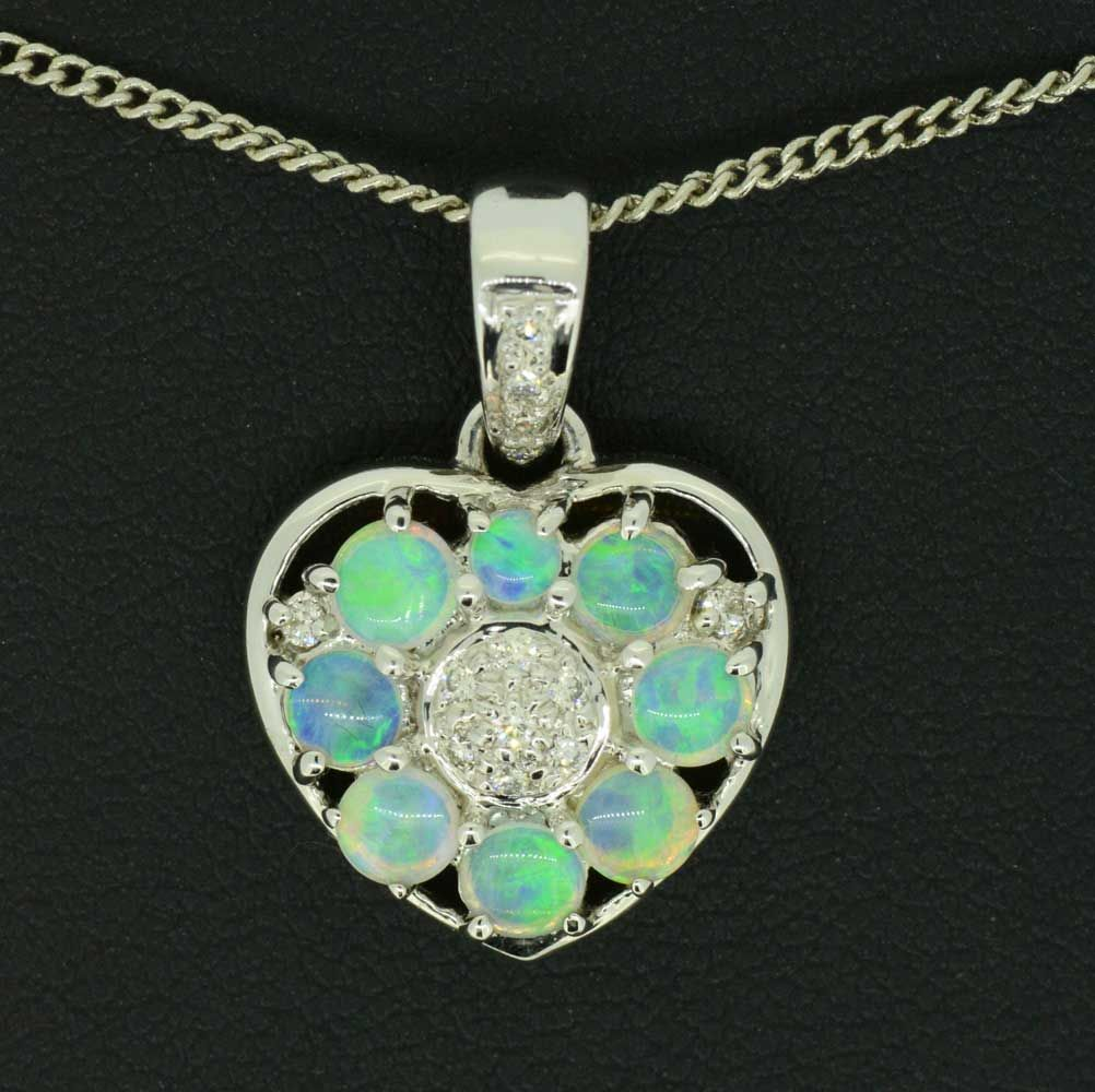 14ct white gold solid opal and diamond pendant