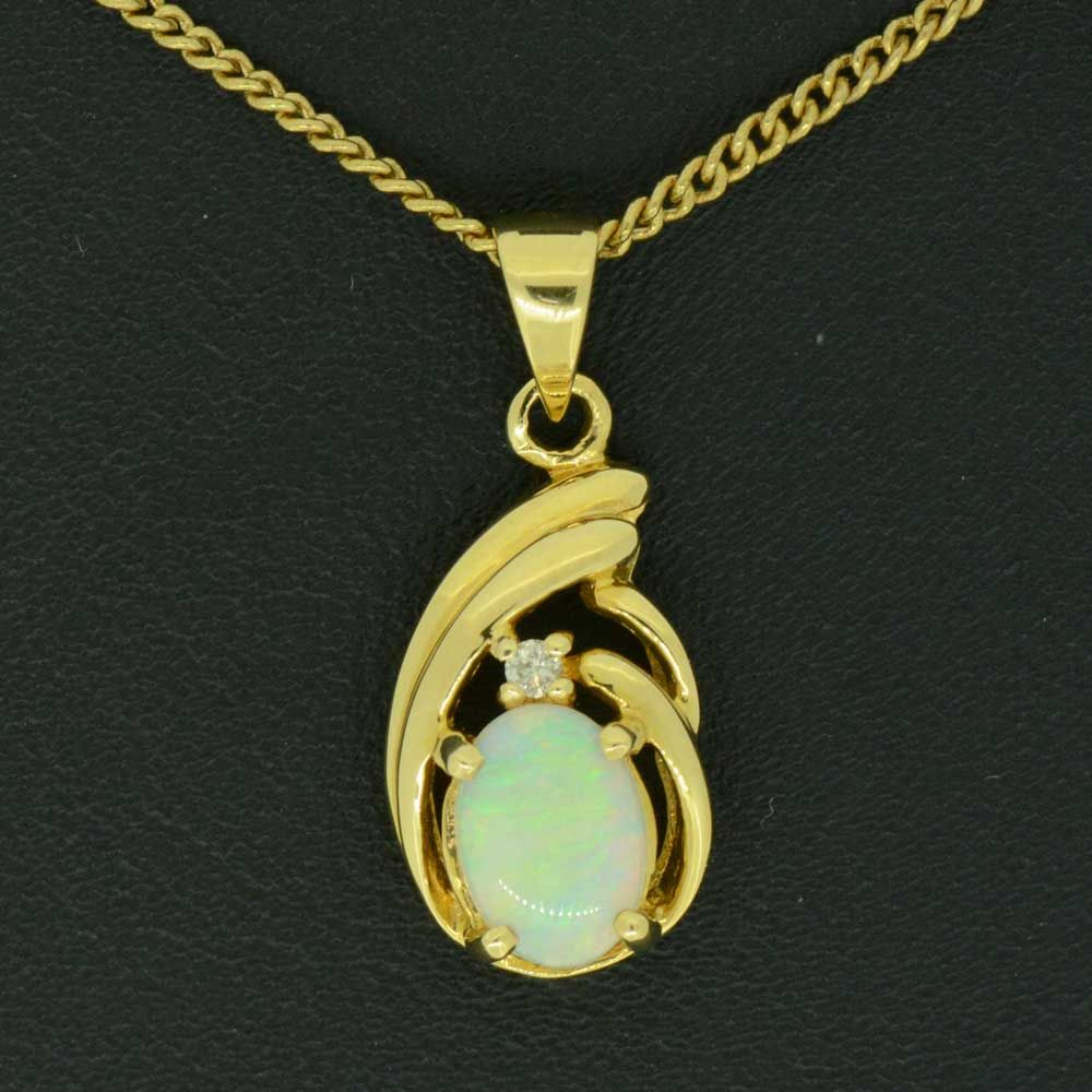 18ct Yellow Gold  Claw Set Solid Opal Pendant with one diamond