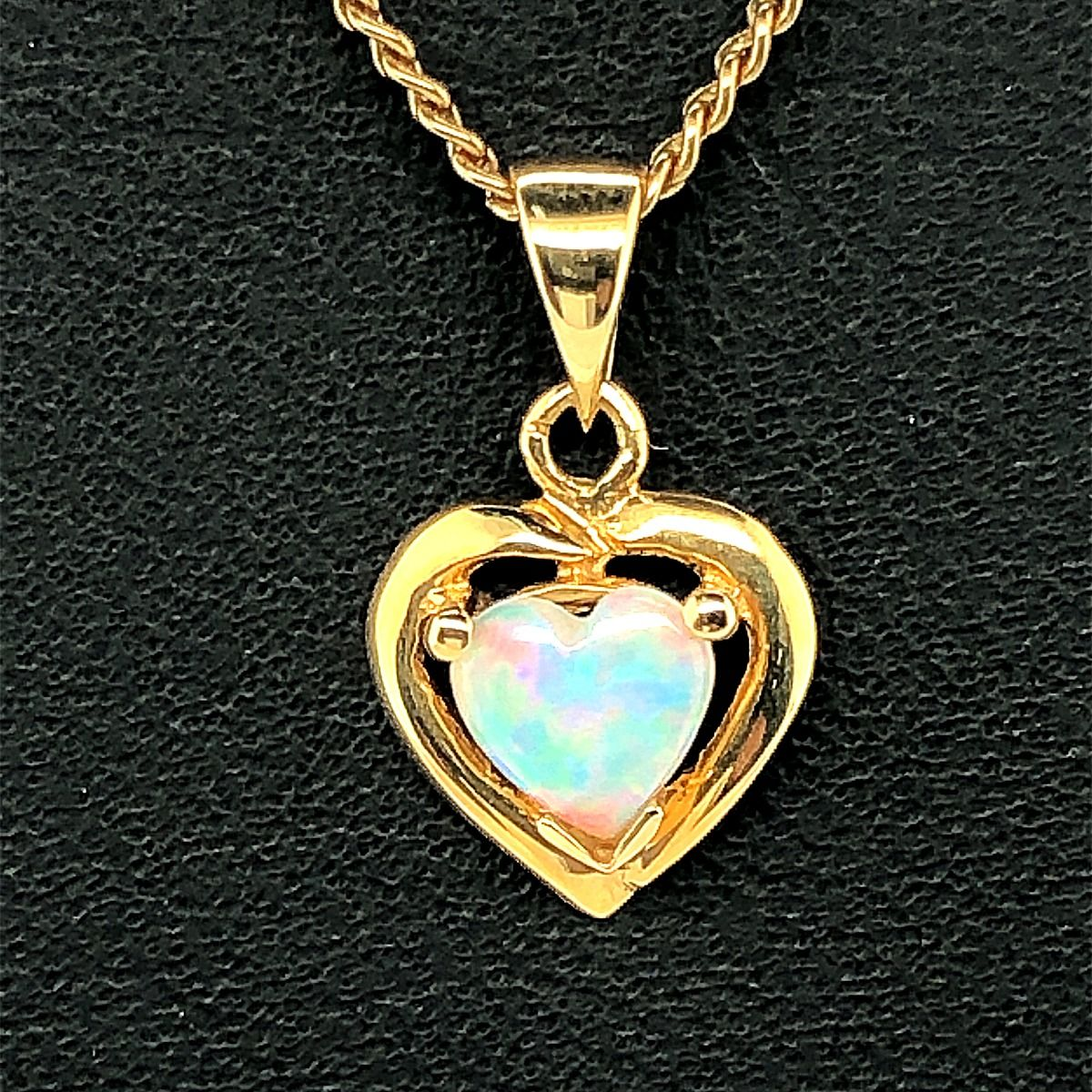 18ct heart shaped solid opal pendant