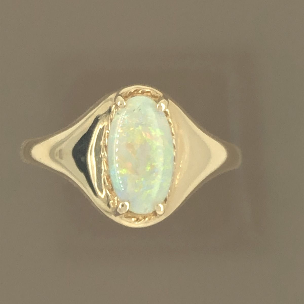 Solid Opal Ring set in 14ct gold (10mmx6mm)