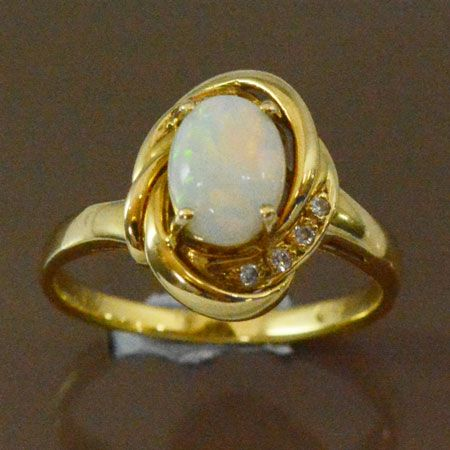 18ct yellow gold solid opal claw set ring