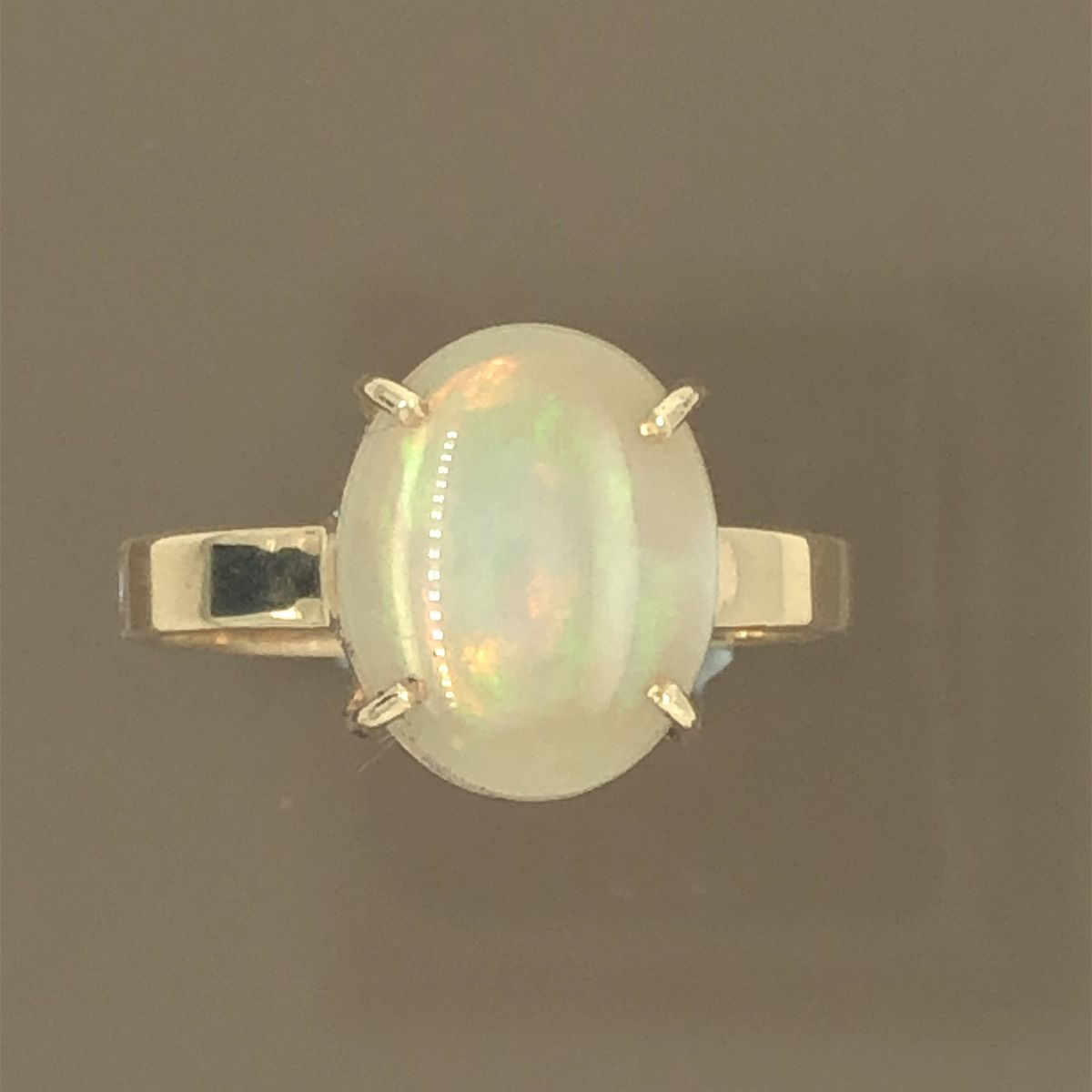 Solid Opal Ring set in 14ct gold (11mmx9mm)