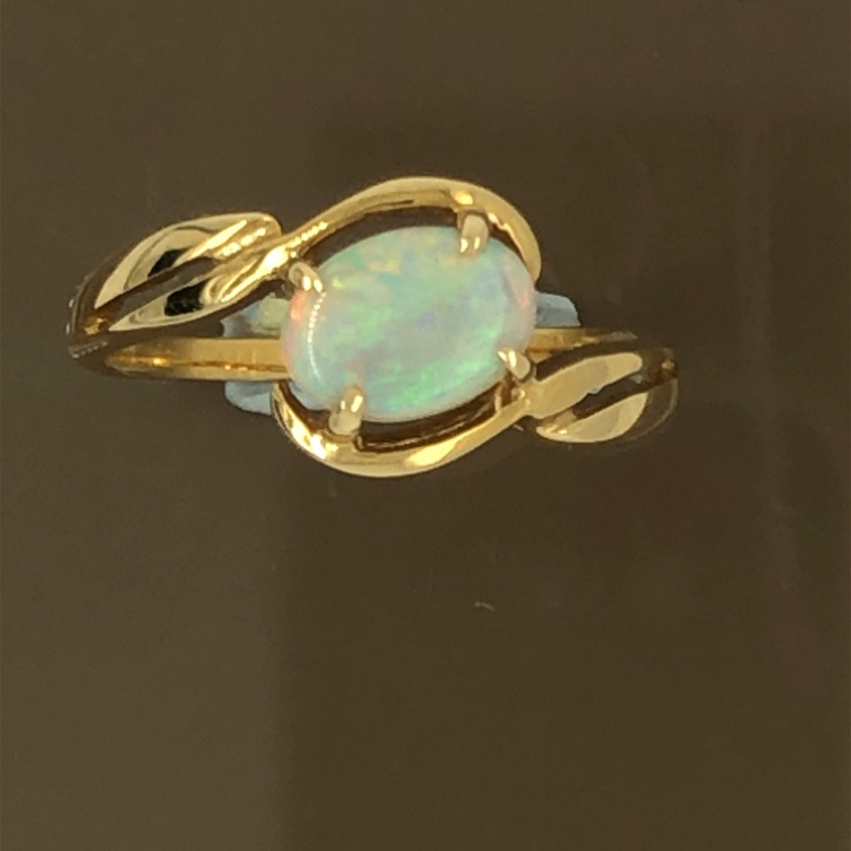 Solid Opal Ring  set in 18ct gold (7mmx5mm)