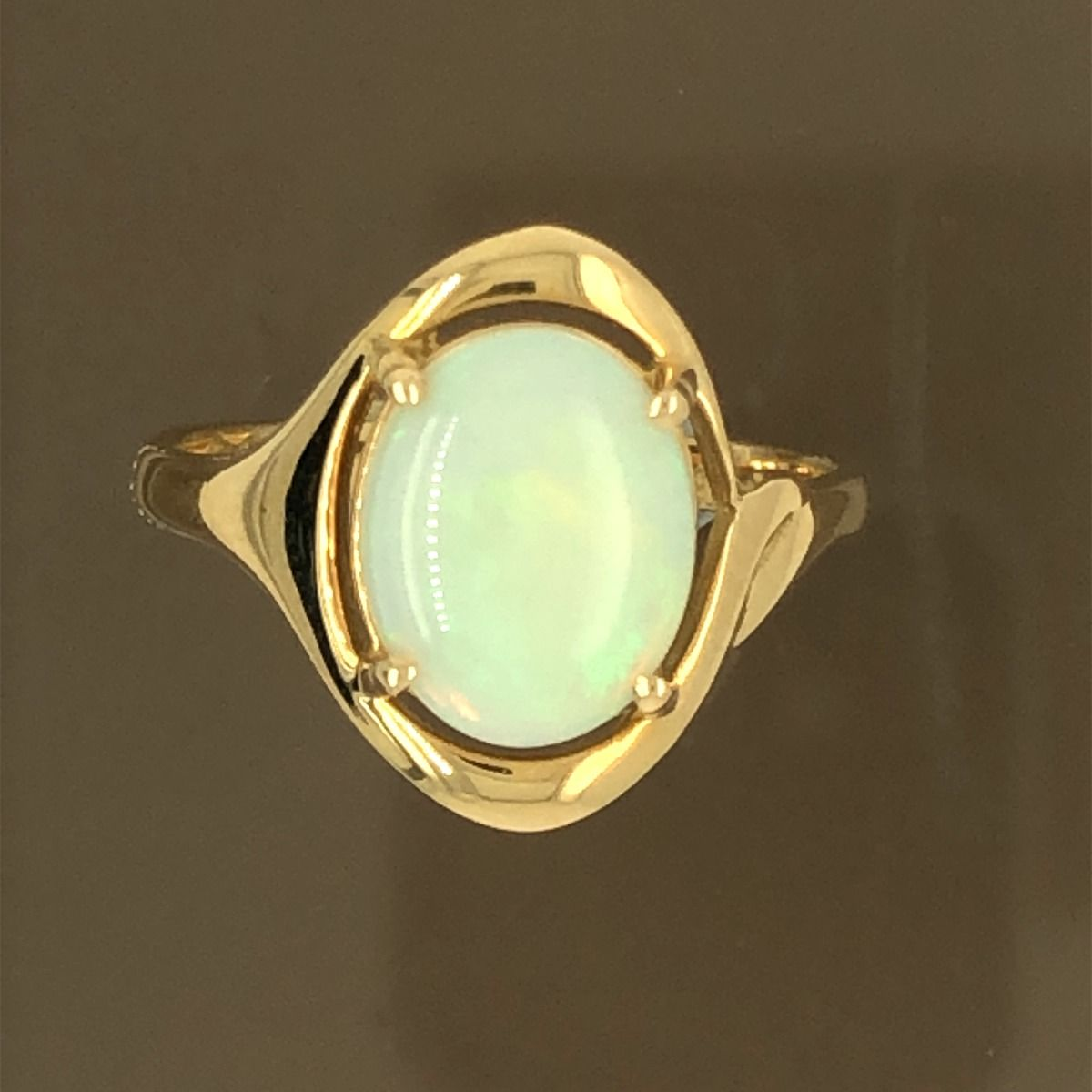 Solid Opal Ring  set in 18ct  gold (10mmx8mm)