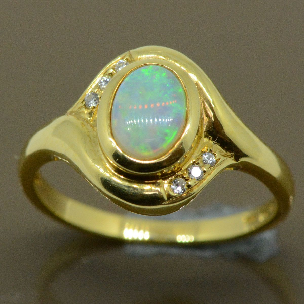 18ct  solid opal ring set with 6 diamonds