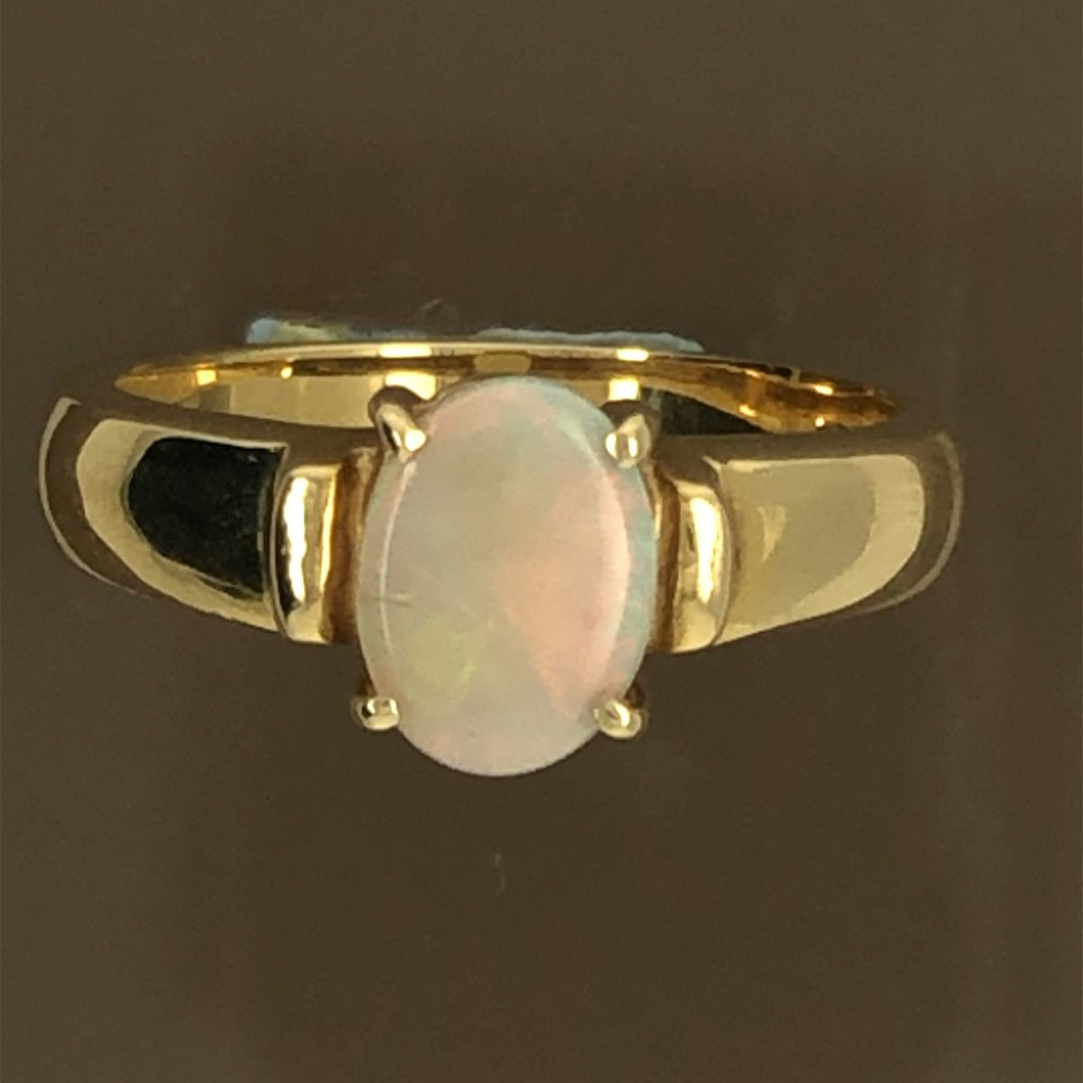 Solid Opal Ring  set in 18ct gold (8mmx6mm)