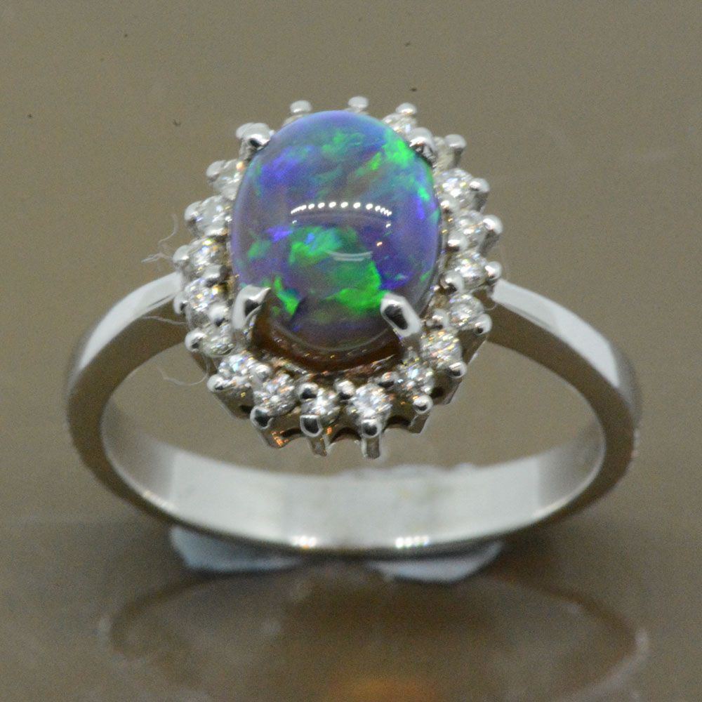 Black opal diamond cluster ring set 18ct white gold