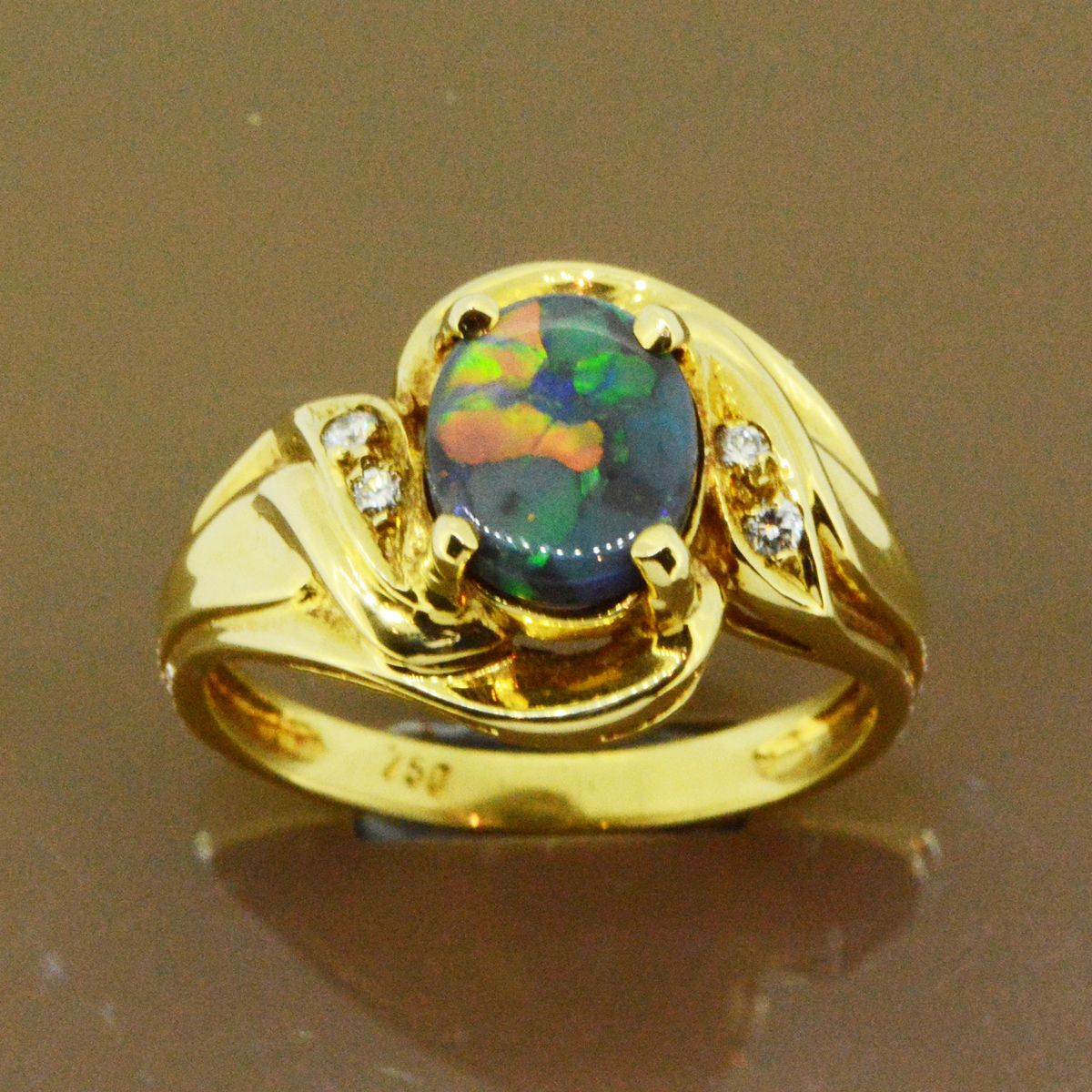 Black opal ring set in 18ct yellow gold (8mmx7mm)