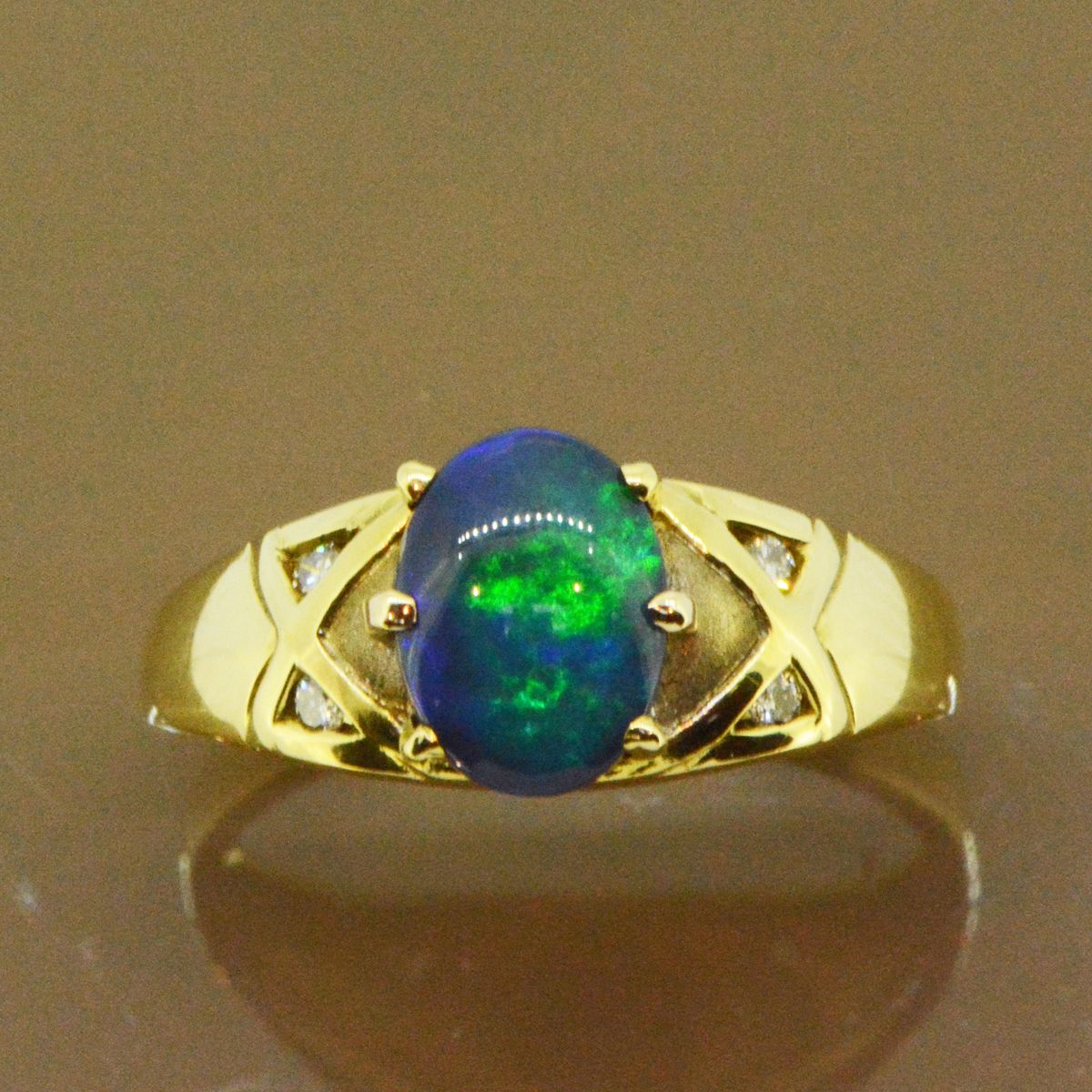 Black opal ring set in 18ct yellow gold (9mmx7mm)
