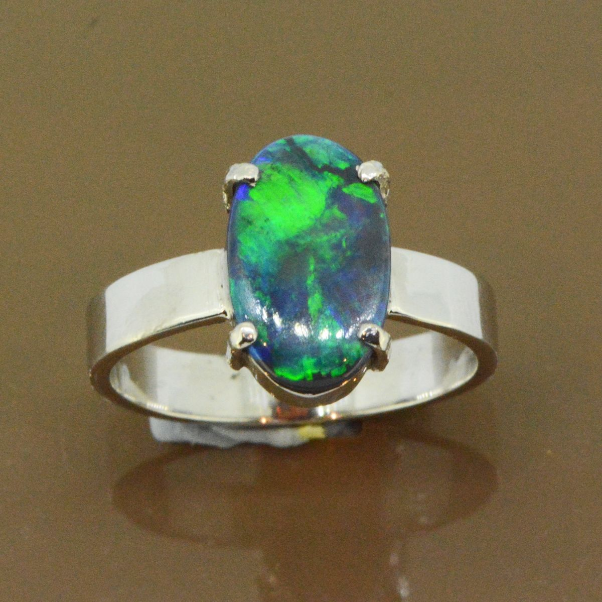 Black opal ring set in 18ct white gold (13mmx8mm)