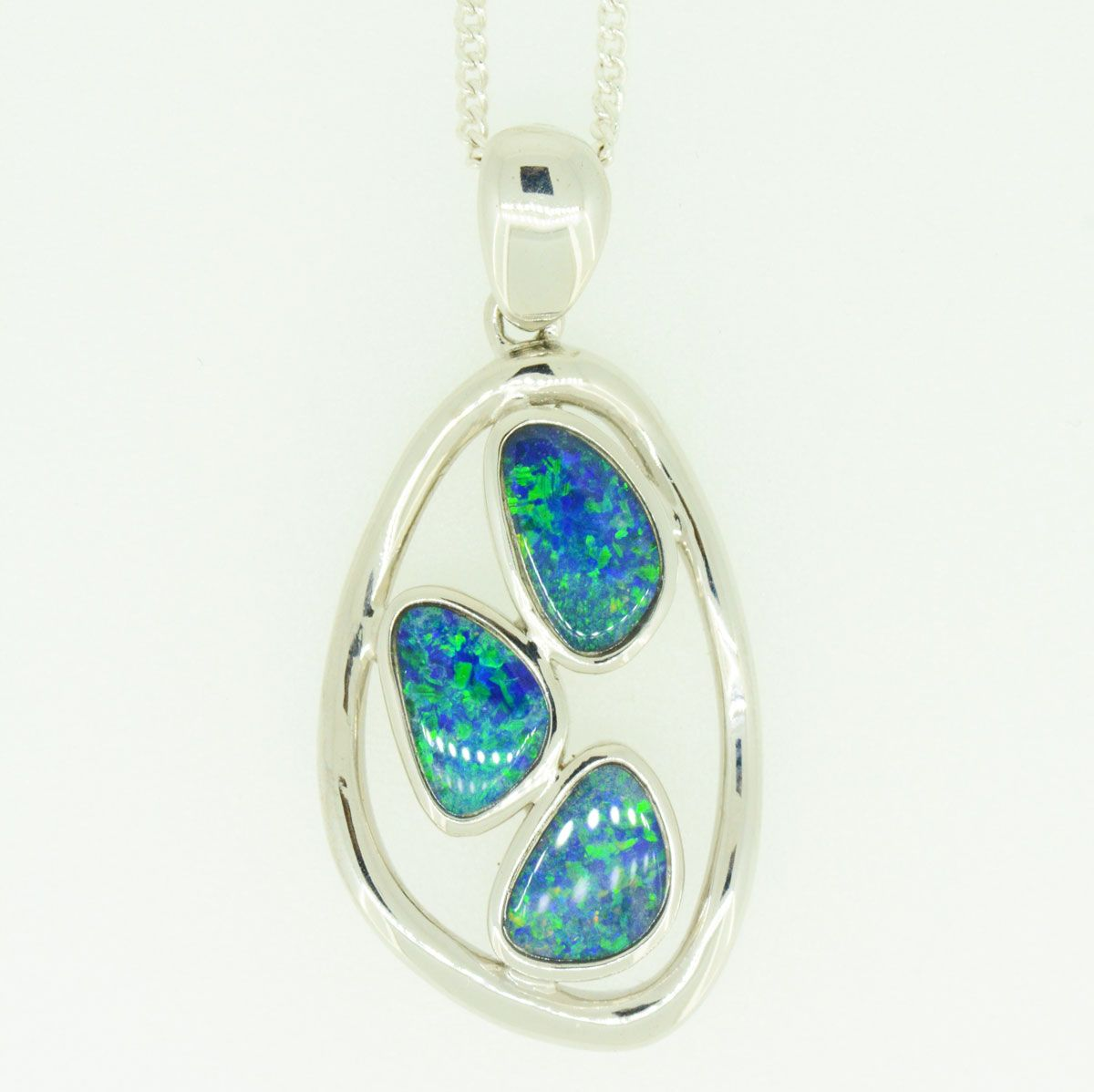 Sterling silver free shape doublet opal pendant with three opals