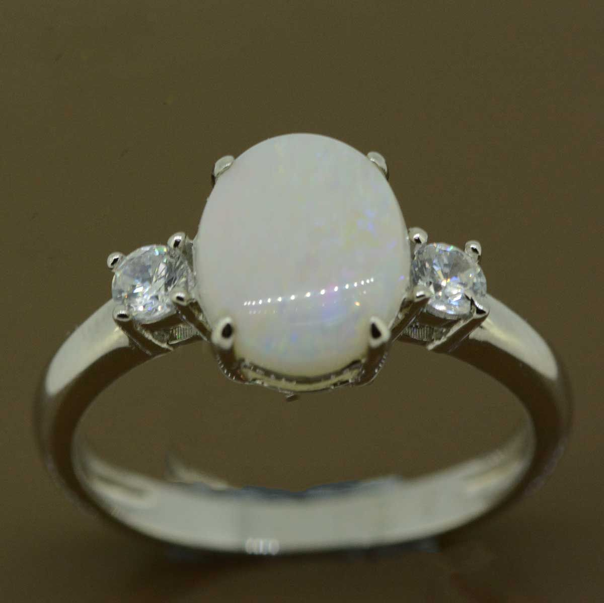 Solid opal ring set in sterling silver 10mmx8mm