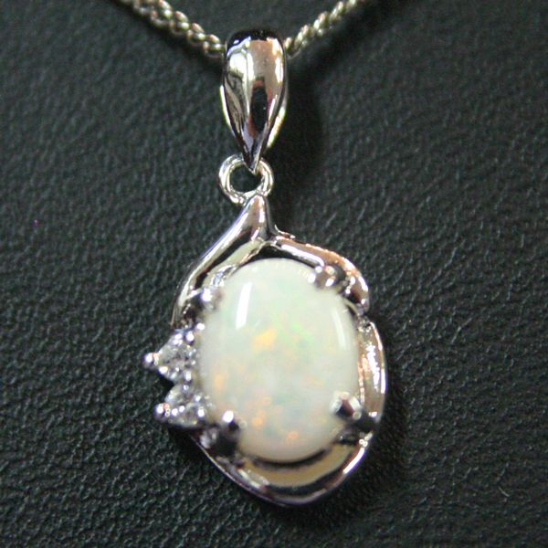 Sterling Silver Claw Set Solid Opal 9mm X 7mm, Pendant set with 2 crystals