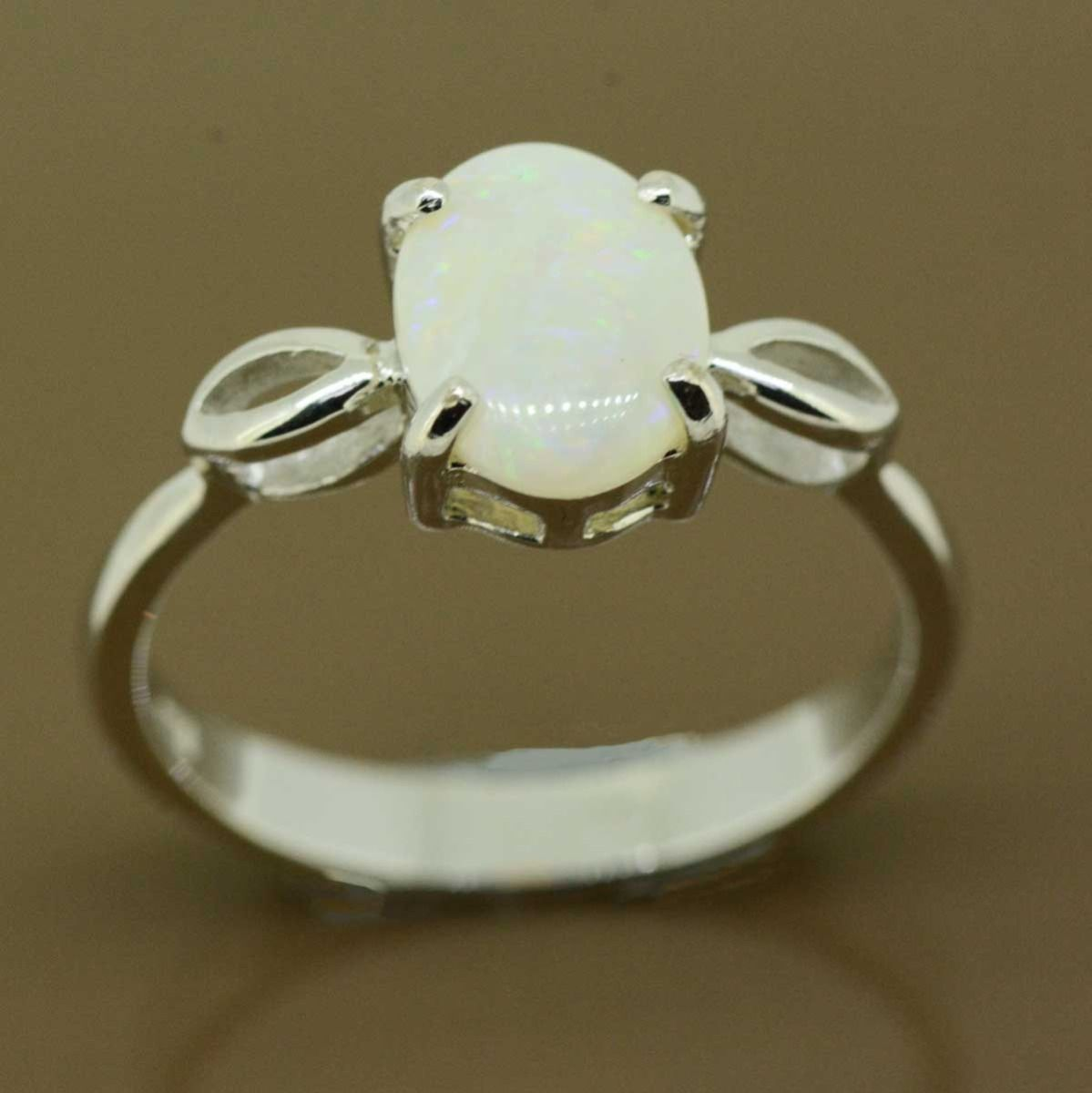 Sterling silver solid opal ring with shoulders