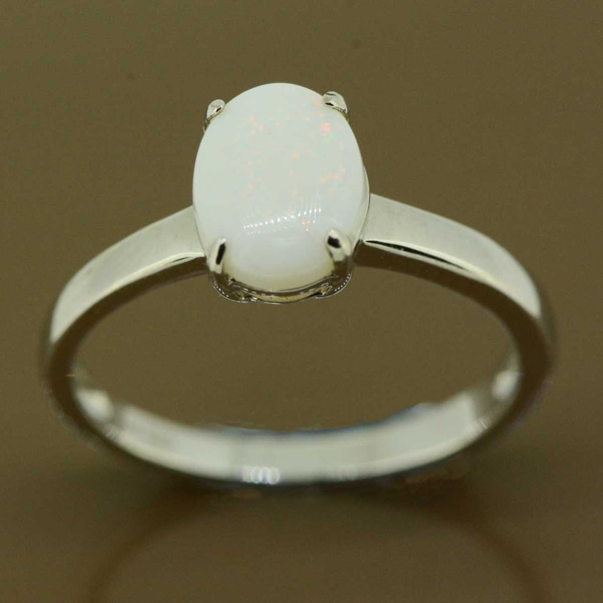 Sterling silver solid claw set opal ring (9x7)
